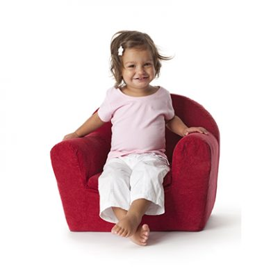 Toddler sitting in armchair